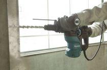 Vrtací a sekací kladivo s výměnným sklíčidlem Makita HR3012FCWJ - SDS-Plus, 1050W, 3.9J, 4.7kg, kufr Makpac